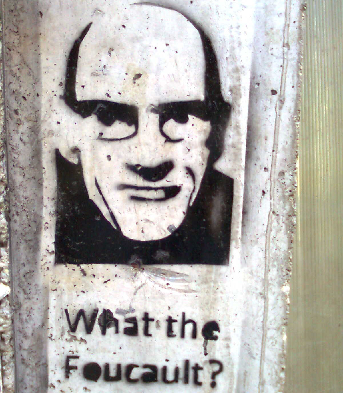 "Graffiti image in black and white featuring an iconic image of Michel Foucault with the text ""What the Foucault?"" underneath"