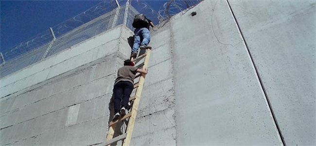 film_still-Infiltrators_by-Khaled-Jarrar__girl climbing wall